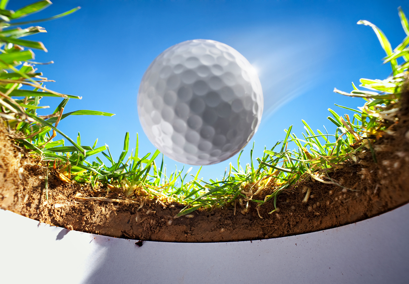 golf ball is falling into the hole