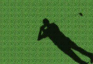 a shadow of golfer in a green fairway