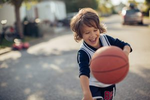 Close up of a young boy playing basketball